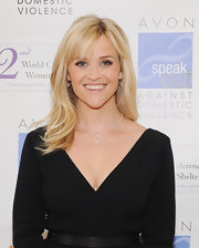 Reese Witherspoon attended the 2012 Avon Communications Awards wearing her lovely blond locks long and sleek with wispy side-swept bangs.