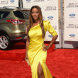 Kenya Moore in one-shouldered draped yellow