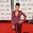 Monica Denise Brown in a burgundy evening suit