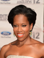 Regina King glammed up her look with a pair of dangling gold and turquoise earrings when she attended the 2012 BET Awards.