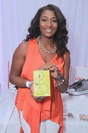 Toccara Jones wore a vibrant wrap-top with an asymmetrical hem at the 2012 BET Awards gift giving suite.