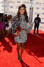 Toccara Jones added a popping piece to her monochromatic ensemble by carrying a hot red metallic python clutch at the BET Awards.