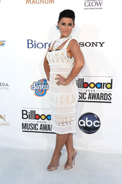 Nelly Furtado paired her ivory crocheted dress with blush satin peep toe pumps.