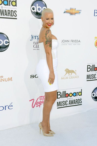 Amber Rose attended the 2012 Billboard Music Awards wearing gold glitter pumps with her crisp white bodycon dress.
