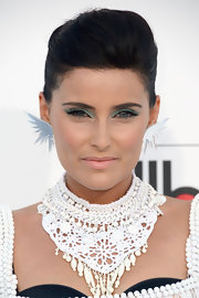 Nelly Furtado attended the 2012 Billboard Music Awards wearing a heavy application of vivid turquoise eyeshadow.