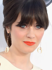 Zooey Deschanel swept on a sparkly citrus shade of lipstick for the 2012 Billboard Music Awards.