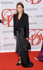 Mary-Kate Olsen debuted her dark locks in this draped high-low hem gown from her own collection.