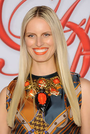 Karolina Kurkova matched her lips to her standout statement necklace.