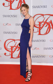 A pair of black strappy sandals completed Britt Robertson's super sexy look during the 2012 CFDA Fashion Awards.