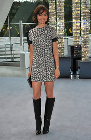 Arizona Muse looked rocker-chic in this mini and knee-high boots.