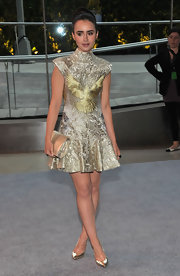 Lily Collins was a brocade beauty in this lavishly adorned metallic dress for the CFDA Fashion Awards.