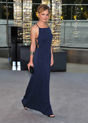 Britt Robertson mesmerized in a back-bearing beaded blue gown at the 2012 CFDA Fashion Awards.