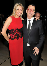 Nadja Swarovski donned a slim-fitting red sheath dress with black lace insert to attend the 2012 CFDA Fashion Awards.