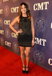 Kacey's dress had a simple cut but interesting stud detailing on the CMT red carpet.