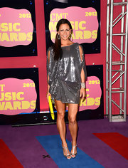 Sara Evans went disco in this silver sequin-saturated mini-dress. Amazingly, it was upstaged by her toned stems. Someone send us this gal's workout regimen stat!