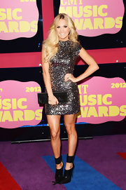 We'll know the world is over when Carrie Underwood steps onto a red carpet in something that doesn't glitter. Fortunately, that hasn't happened yet.
