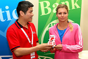 Maria Kirilenko posed for pictures in a bright pink Adidas track jacket at the 2012 China Open.