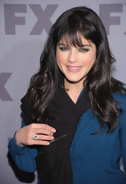 Selma Blair attended the 2012 FX Ad Sales Upfront event wearing her glossy tresses in long layers with wispy bangs.