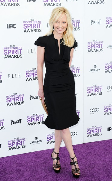 Anne Heche accessorized her LBD with platform strappy sandals.
