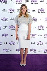 Elizabeth Olsen looked demure in light gray stilettos.