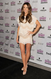 Kate Beckinsale showed off her tanned and toned legs in nude platform pumps.