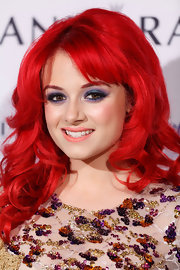 Sarah De Bono played up the vibrancy of her ferocious red hair with powerful purple eyeshadow.