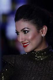 Gauhar Khan kept her jewelry to a minimum, but she still looked super luxurious with her diamond stud earrings.