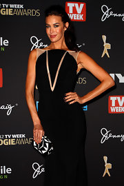 Megan Gale attended the 2012 Logie Awards carrying a black-and-white geometric hard-case clutch.