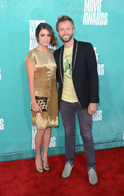 Nikki Reed and Paul McDonald were attached at the hip during their red carpet stroll. The actress looked luminous in her gold key-hole Randi Rahm dress and matching heels.