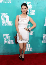 Fivel Stewart attended the 2012 MTV Movie Awards wearing a white mini dress.
