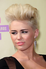 Miley Cyrus debuted her daring new 'do at the MTV VMAs.