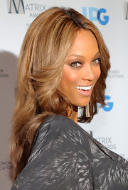 Tyra Banks wore her lightened layered tresses in feathered waves at the 2012 Matrix Awards luncheon.