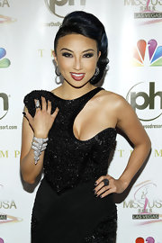 Jeannie Mai continued the dark theme all the way down to her nail polish.