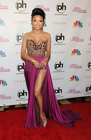 Jeannie Mai showed some leg in this beaded number with a hot fuchsia silk skirt at the Miss Universe Pageant.