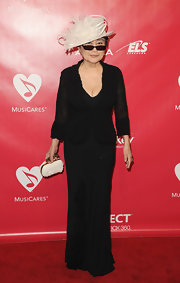 Yoko Ono wore a classic floor-length black dress with a generous neckline as she attended the MusiCares tribute for Sir Paul McCartney.