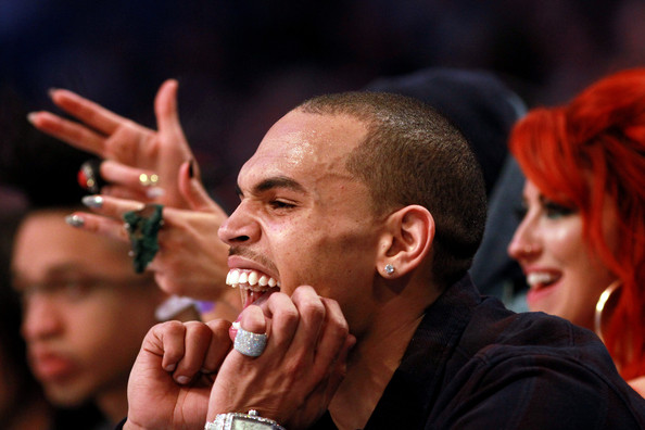 Chris Brown wore a glittery ring while screaming with glee at 2012's NBA All-Star Game.