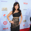 Mayte Garcia in Black, Gold, and Print