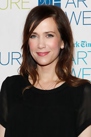 Kristen Wiig wore her hair casually down with soft waves and a sexy side part at the 2012 'New York Times' Arts & Leisure Weekend.