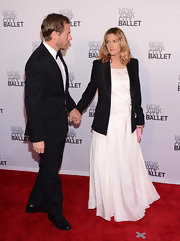 Drew Barrymore tossed on a black blazer over her white gown for a sophisticated effect at the New York City Ballet's Spring Gala.