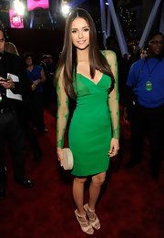 Nina Dobrev rocked a kelly green dress paired with nude strappy sandals.