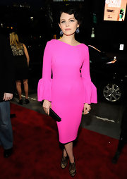 Ginnifer Goodwin offset her hot pink cocktail dress with a sleek minimalist clutch.