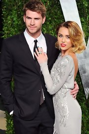 Miley Cyrus complemented her embellished gray gown with a chunky pearl ring by Lorraine Schwartz.