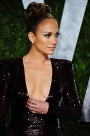 Jennifer Lopez attended the 2012 'Vanity Fair' Oscar Party wearing a pair of 18-carat noble gold and diamond earrings along with a variety of 18-carat white gold and diamond rings.