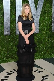 Elizabeth Olsen opted for a classic look, wisely wearing a chic black dress.
