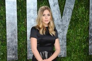 Actress Elizabeth Olsen arrives at the 2012 Vanity Fair Oscar Party hosted by Graydon Carter at Sunset Tower on February 26, 2012 in West Hollywood, California.