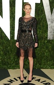 Kate Bosworth contrasted her heavily embellished dress with a simple yet elegant black satin clutch by Christian Dior.