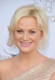 Amy Poehler attended the 2012 Writers Guild Awards wearing her hair in a loosely pinned-up 'do with softly side-swept bangs.