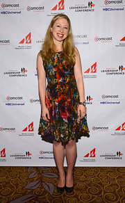 This gorgeously vibrant cocktail dress made Chelsea Clinton shine.
