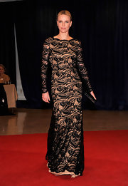 Charlize Theron knows how to make a red carpet appearance! Check out this dramatic lace gown.