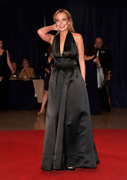 Lindsay Lohan made an unexpected appearance at the White House Correspondents' Dinner in this v-neck gown with a nipped waist.